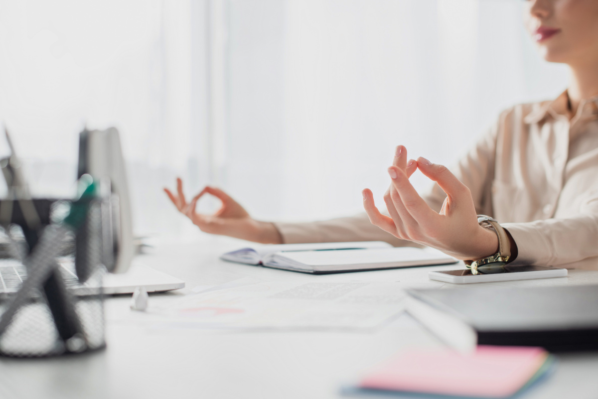 Businesswoman Meditating at Desk