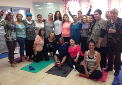 Smiling Women Posing Together in Yoga Studio